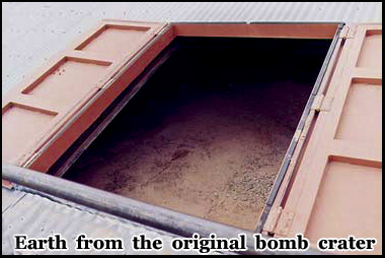 Earth from the original bomb crater is preserved beneath iron bunkers