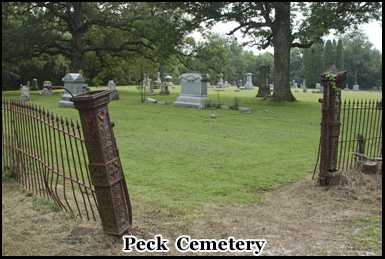 The entrance to Peck Cemetery, ghostly hooded figures have been sighted here