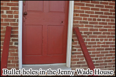 A bullet hole in the front door of the Jenny Wade house